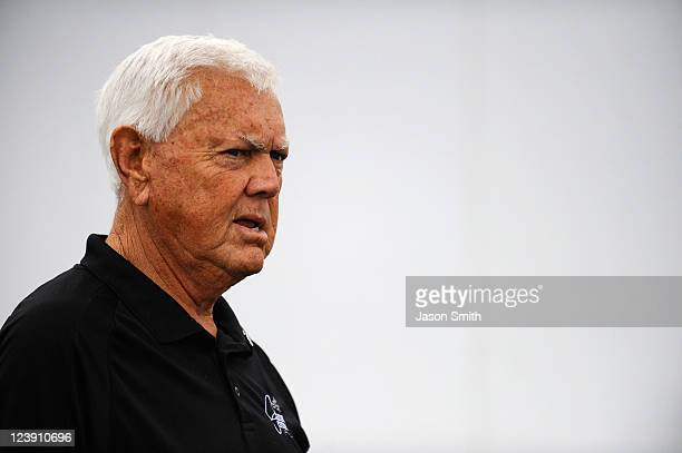 Hall of Fame member Junior Johnson stands in the garage area prior to the NASCAR KN Series Kevin Whitaker 140 held at Greenville Pickens Speedway on...