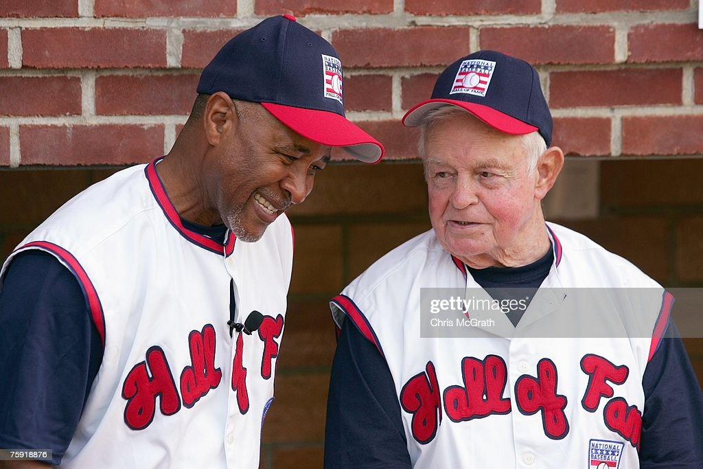 Hall of Fame member Ozzie Smith laughs with Earl Weaver during the Play Ball with Ozzie Smith Clinic held at Doubleday Field on July 27, 2007 in Cooperstown, New York.