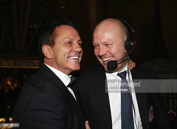 Hall of Fame members Doug Gilmour and Mats Sundin walk the red carpet prior to the induction ceremony at the Hockey Hall of Fame on November 17 2014...