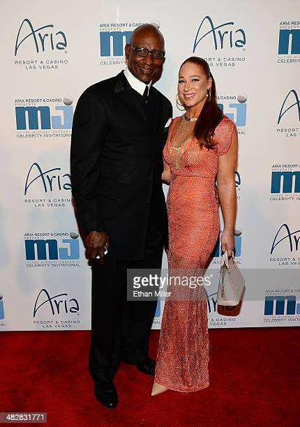 Hall of Fame National Football League player Eric Dickerson and guest arrive at the 13th annual Michael Jordan Celebrity Invitational gala at the...