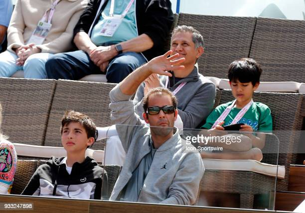 Hall of Fame Pete Sampras waives to the crowd during a semifinal match between Roger Federer and Borna Coric at the BNP Paribas Open on March 17 at...