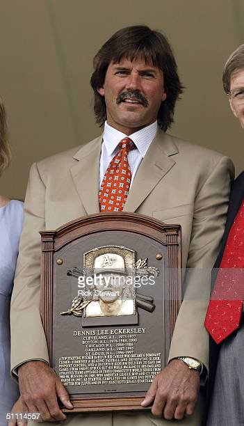 Hall of Fame pitcher, Dennis Eckersley, stands with his induction plaque during the National Baseball Hall of Fame Induction Ceremonies on July 25,...