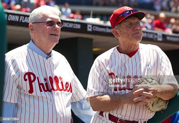 Hall of Fame pitcher Jim Bunning and bench coach Larry Bowa of the Philadelphia Phillies wait in the dugout prior to the game against the Chicago...