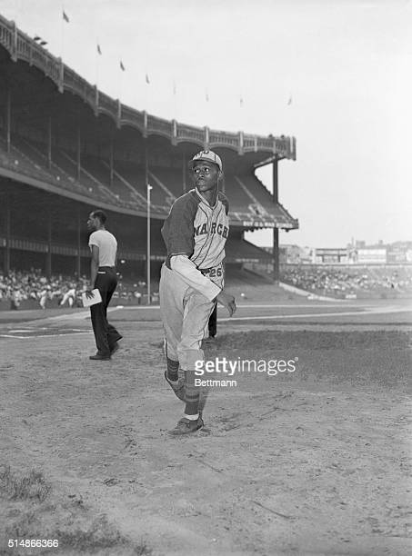 Hall of Fame pitcher Satchel Paige throws before a game. He wears the uniform of the Kansas City Monarchs, a team in the Negro National League.