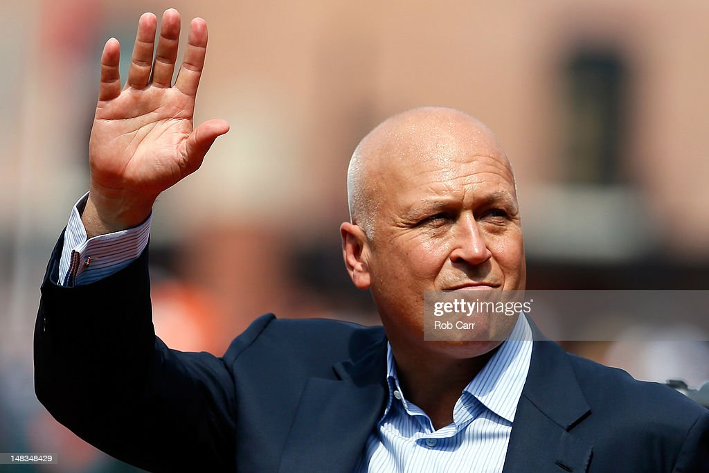 Hall of fame player and former Baltimore Orioles Cal Ripken Jr., waves to the crowd during pre game ceremonies before the start of the Orioles and Detroit Tigers game at Oriole Park at Camden Yards on July 14, 2012 in Baltimore, Maryland.