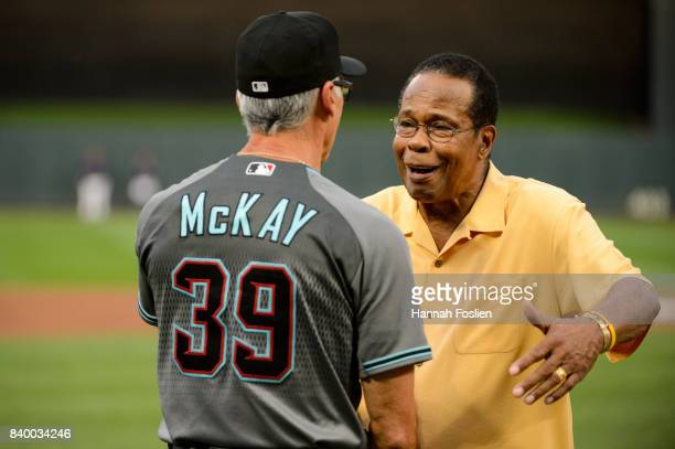 Hall of Fame player Rod Carew hugs first base coach Dave McKay of the Arizona Diamondbacks before the game against the Minnesota Twins on August 18...