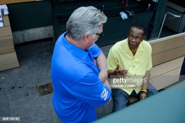 Hall of Fame player Rod Carew speaks to former player Jack Morris during batting practice before the game between the Minnesota Twins and the Los...
