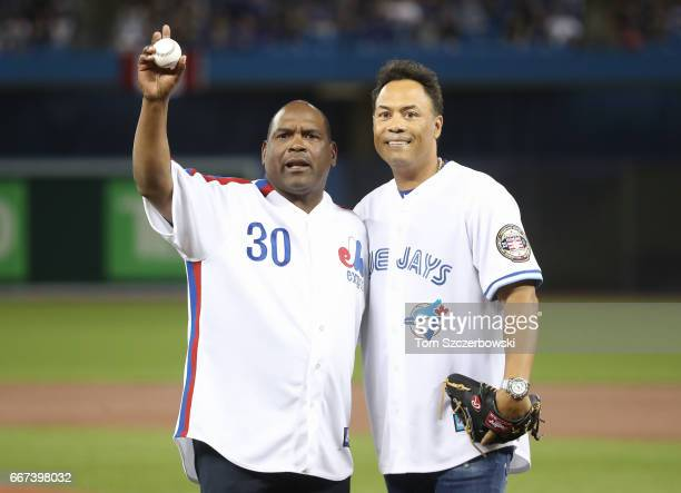 Hall of Fame players Tim Raines and Roberto Alomar after the ceremonial first pitch prior to the start of the Toronto Blue Jays home opener against...