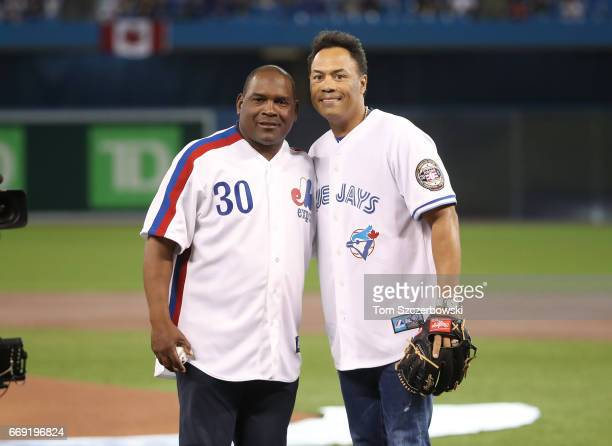 Hall of Fame players Tim Raines and Roberto Alomar pose after the ceremonial first pitch prior to the start of the Toronto Blue Jays home opener...