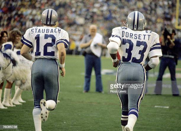 Hall of Fame quarterback Roger Staubach and running back Tony Dorsett of the Dallas Cowboys come out for player introductions just before the Cowboys...