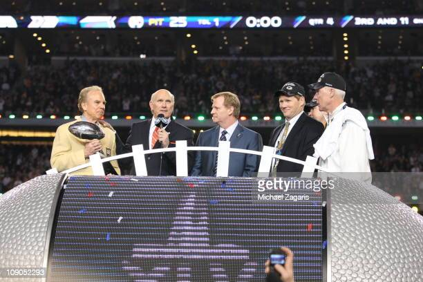 Hall of Fame quarterback Roger Staubach presents the Vince Lombardi Trophy to NFL commissioner Roger Goodell as Hall of Famer Terry Bradshaw of Fox...