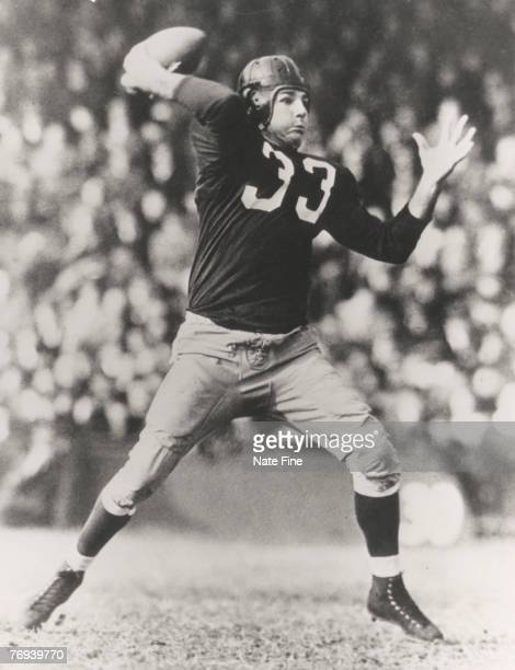 Hall of Fame quarterback Sammy Baugh of the Washington Redskins readies to throw a pass during the 1940 season