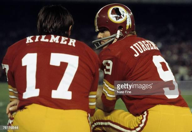 Hall of Fame quarterback Sonny Jurgensen of the Washington Redskins talks with backup Billy Kilmer during the Redskins 147 victory over the Dallas...