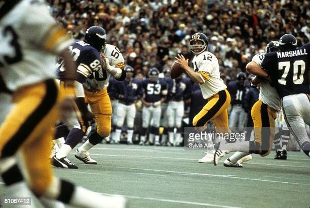 Hall of Fame quarterback Terry Bradshaw of the Pittsburgh Steelers looks for an open receiver during the Steelers 166 victory over the Minnesota...