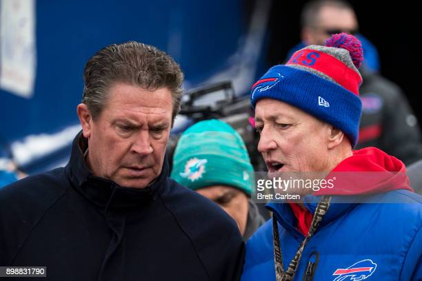 Hall of Fame quarterbacks Dan Marino and Jim Kelly talk before the game between the Buffalo Bills and the Miami Dolphins at New Era Field on December...