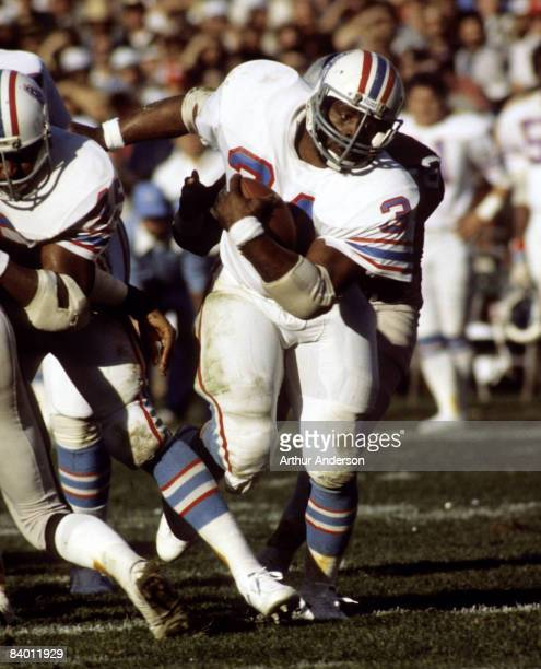 Hall of Fame running back Earl Campbell of the Houston Oilers carries the ball and looks for room to run during a 27-7 loss to the Oakland Raiders in...