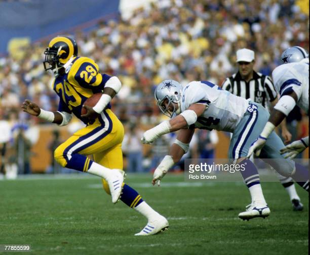 Hall of Fame running back Eric Dickerson of the Los Angeles Rams carries the football and outruns the defensive pursuit during the Rams 200 victory...