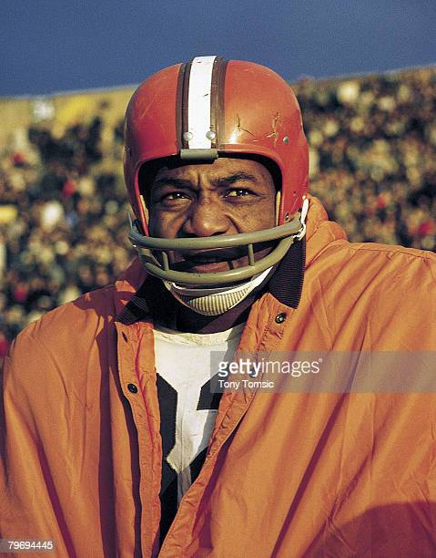Hall of Fame running back Jim Brown of the Cleveland Browns watches from the sideline.
