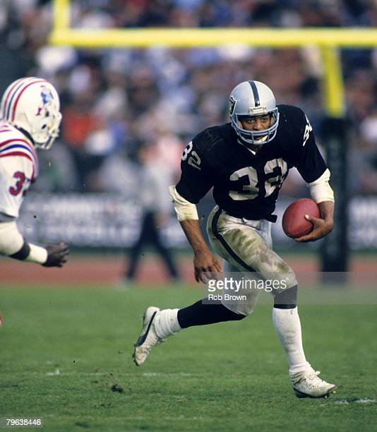 Hall of Fame running back Marcus Allen of the Los Angeles Raiders carries the football and looks for room to run during the Raiders 27-20 loss to the...