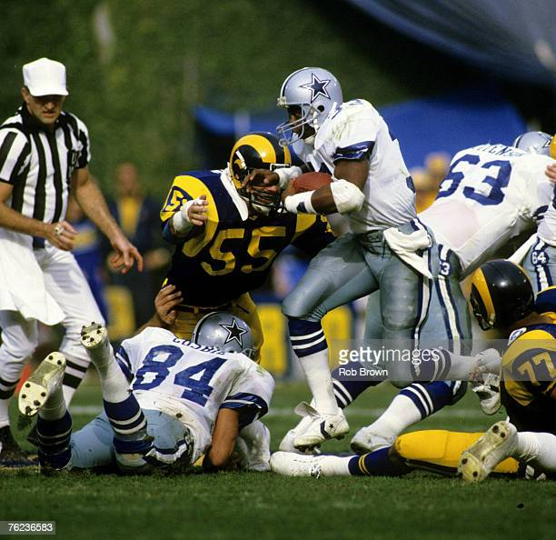 Hall of Fame running back Tony Dorsett of the Dallas Cowboys carries the football and scoots through the hole during the Cowboys 200 loss to the Los...