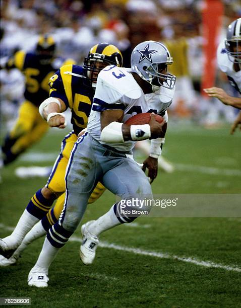 Hall of Fame running back Tony Dorsett of the Dallas Cowboys carries the football and looks for room to run during the Cowboys 200 loss to the Los...