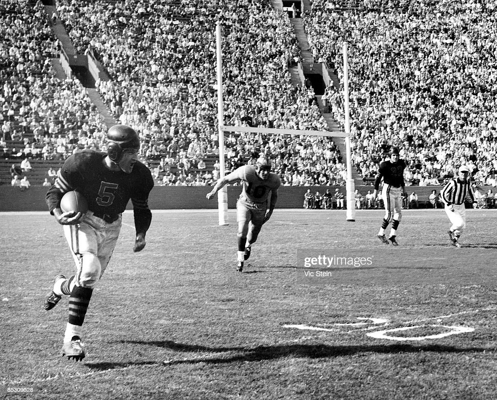 Hall of Fame running back/defensive back George McAfee #5 of the Chicago Bears breaks away from defensive back Tom Keane of the Los Angeles Rams in a 21-6 win over the Rams on November 7, 1948 at the Los Angeles Coliseum in Los Angeles, California.