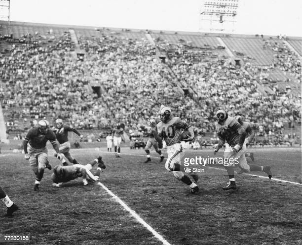 Hall of Fame wide receiver Elroy 'Crazylegs' Hirsch of the Los Angeles Rams runs upfield in a 42 to 14 win over the Green Bay Packers on December 16...