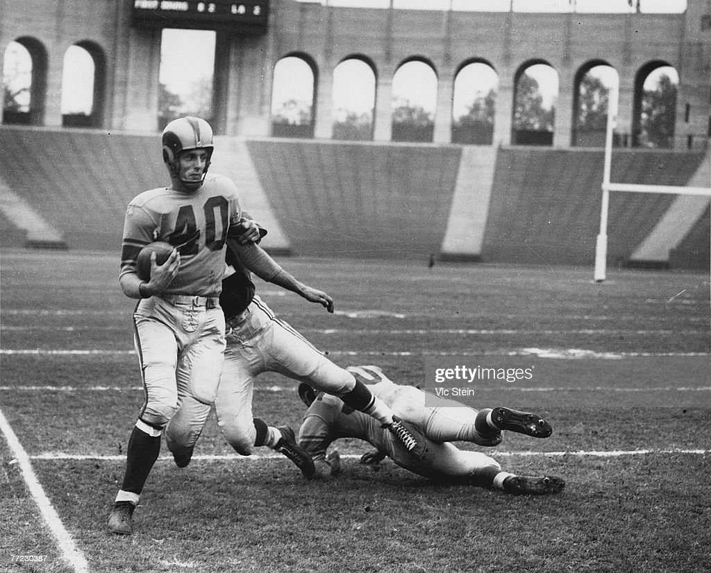 Hall of Fame wide receiver Elroy 'Crazylegs' Hirsch of the Los Angeles Rams makes runs upfield in a 1950 game played at Memorial Coliseum in Los Angeles, California.