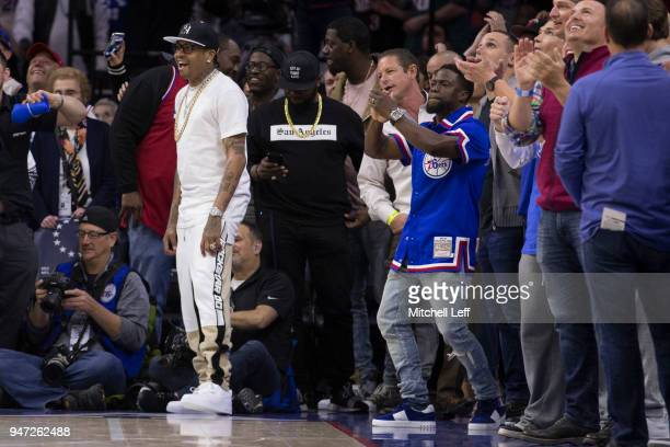 Hall of Famer Allen Iverson and comedian Kevin Hart react from the seats during a timeout in the fourth quarter of Game Two of the first round of the...