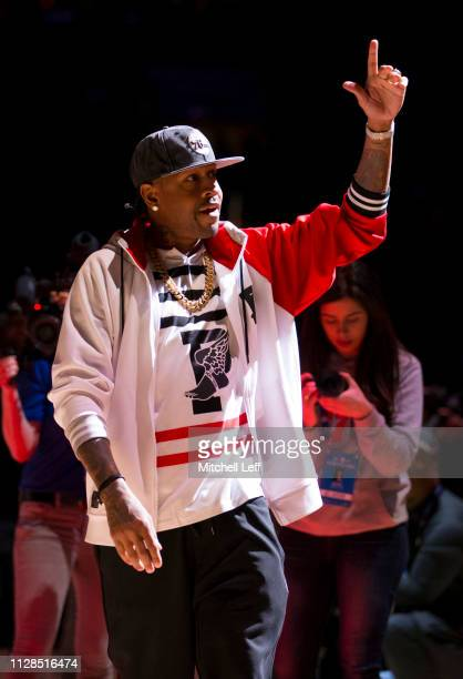 Hall of Famer Allen Iverson encourages the crowd to get loud prior to the game between the Toronto Raptors and Philadelphia 76ers at the Wells Fargo...