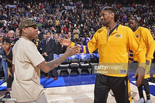 Hall of Famer Allen Iverson shakes hands with Metta World Peace of the Los Angeles Lakers before the game against the Philadelphia 76ers at the Wells...