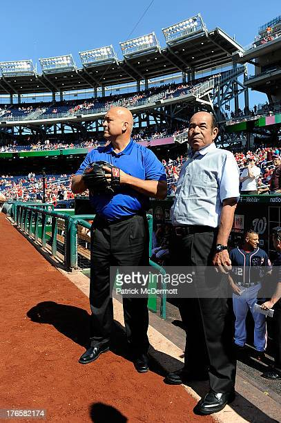 Hall of Famer and former Baltimore Orioles player Cal Ripken Jr waits with former Japanese player Sachio Kinugasa before a ceremonial first pitch...