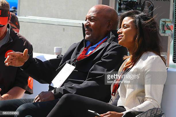 Hall of Famer and Former Brown Jim Brown and his wife on the field prior to the game between the New York Jets and the Cleveland Browns played at...