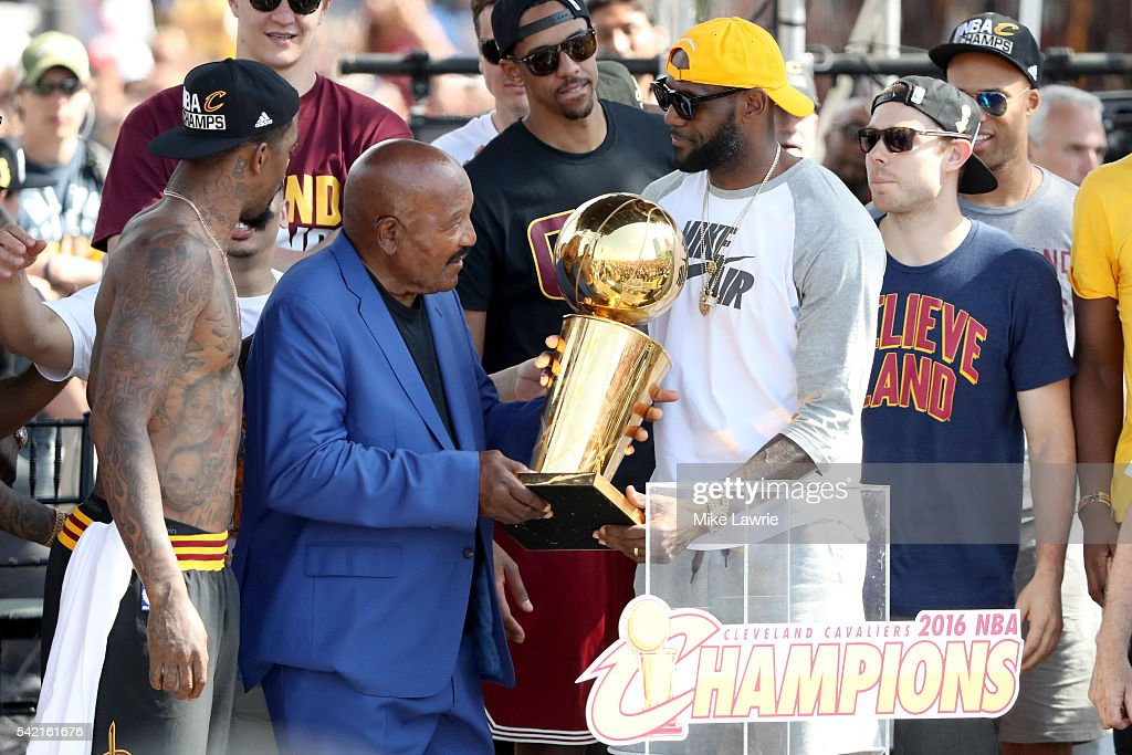 NFL Hall of Famer and former Cleveland Brown Jim Brown hands the Larry O'Brien Trophy to LeBron James #23 of the Cleveland Cavaliers during the Cleveland Cavaliers 2016 NBA Championship victory parade and rally on June 22, 2016 in Cleveland, Ohio.