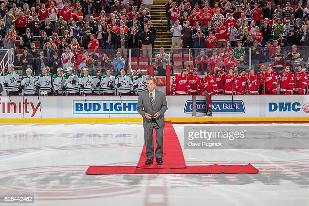 Hall of Famer and former Detroit Red Wing Ted Lindsay walks out to center ice for the ceremonial puck prior to an NHL game between the Detroit Red...