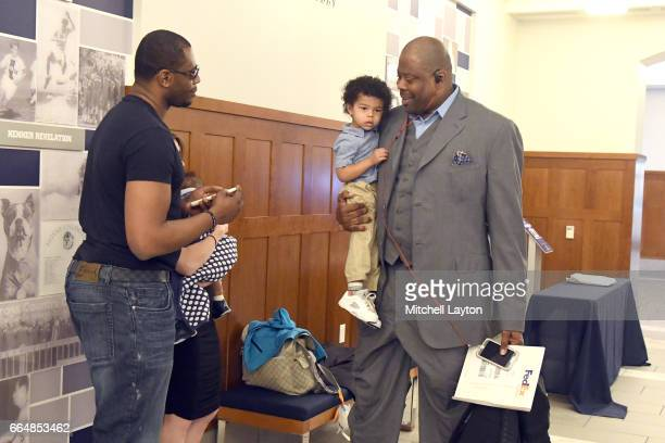 Hall of Famer and former Georgetown Hoyas player Patrick Ewing with son Patrick Jr and grandson Trey visit before being introduced as the Georgetown...
