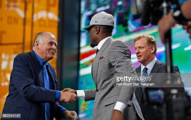 NFL Hall of Famer and former Green Bay Packer Jerry Kramer left greets the Packers' 45th overall pick Iowa cornerback Josh Jackson in the second...
