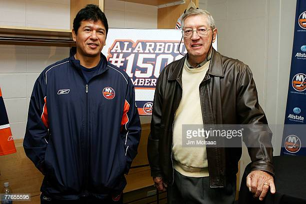 Hall of Famer and former head coach of the New York Islanders Al Arbour poses for a photograph with current coach Ted Nolan during a press conference...