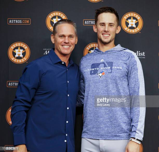 Hall of Famer and former Houston Astro Craig Biggio and his son Cavan Biggio of the Toronto Blue Jays pose for a photo after a press conference at...