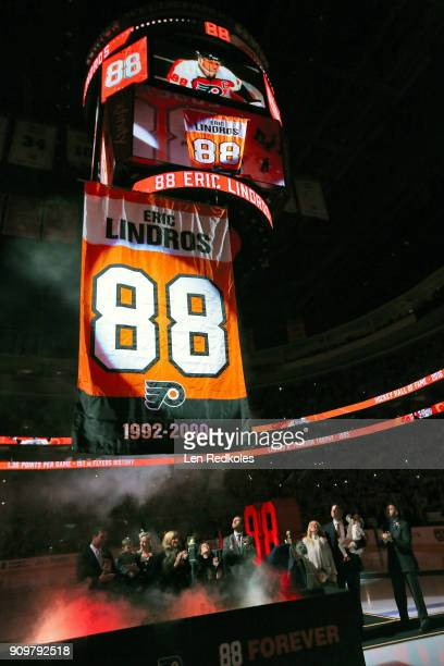 Hall of Famer and former Philadelphia Flyer Eric Lindros and his family along with former teammates John LeClair and Mikael Renberg watch as his...