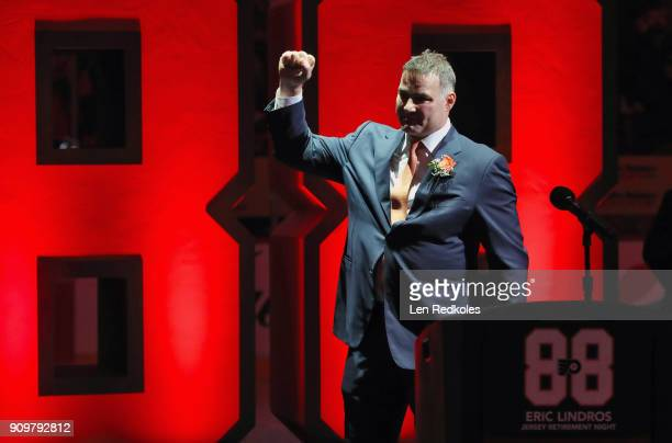 Hall of Famer and former Philadelphia Flyer Eric Lindros reacts to the crowd during his Jersey Retirement Night ceremony prior to a NHL game between...