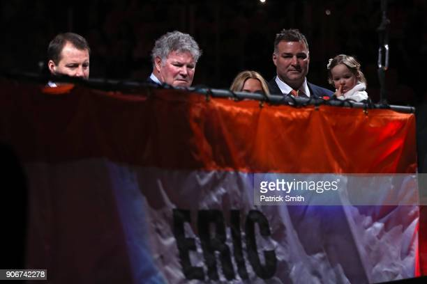 Hall of Famer and former Philadelphia Flyer Eric Lindros watches as his banner is lifted to the rafters during his Jersey Retirement Night ceremony...