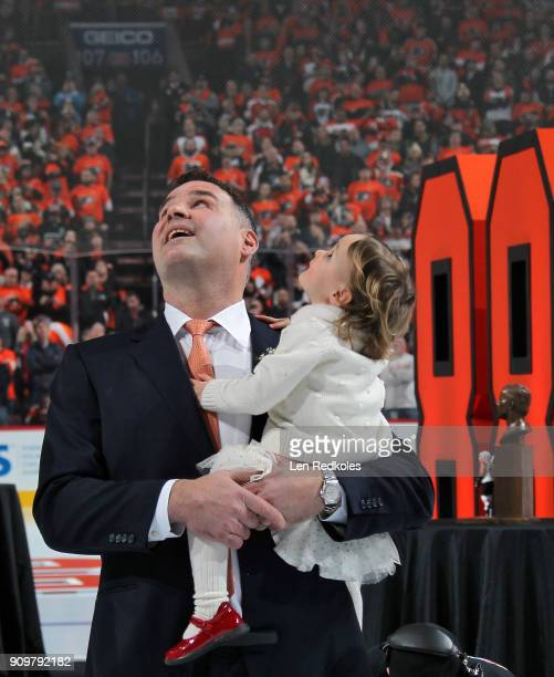 Hall of Famer and former Philadelphia Flyer Eric Lindros with his Daughter Sophie look up during his Jersey Retirement Night ceremony prior to a NHL...