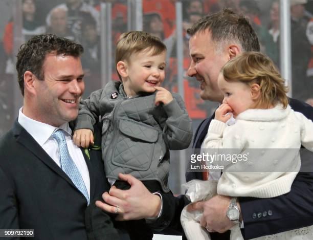 Hall of Famer and former Philadelphia Flyer Eric Lindros with his Daughter Sophie Son Carl and Brother Brett share a moment during his Jersey...