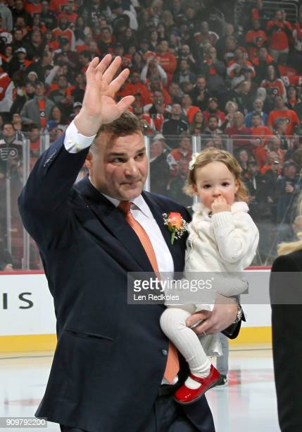 Hall of Famer and former Philadelphia Flyer Eric Lindros with his Daughter Sophie wave to the crowd during his Jersey Retirement Night ceremony prior...