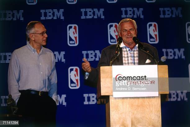 Hall of Famer and former UNC coach Dean Smith presents Philadelphia 76ers head coach Larry Brown with the 2001 NBA Coach of the Year award on May 27...