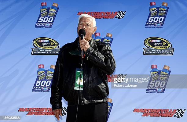 Hall of Famer and race Grand Marshal Junior Johnson speaks before the start of the NASCAR Sprint Cup Goody's Headache Relief Shot 500 Powered By...