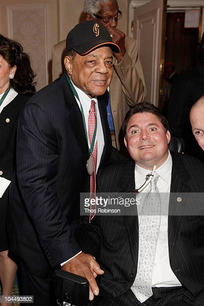 Hall of Famer and Sports Legend Honoree Willie Mays poses with Marc Buoniconti at the 25th Great Sports Legends Dinner to benefit The Buoniconti Fund...