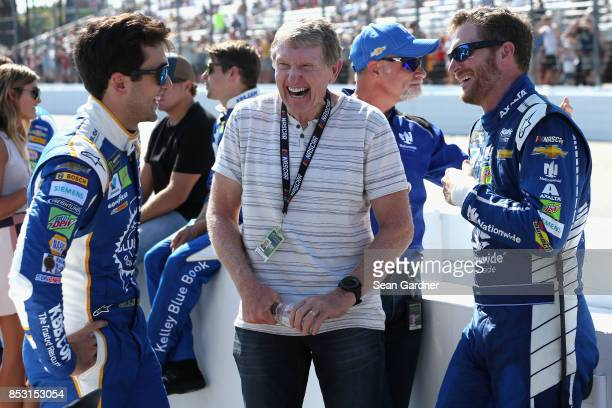 Hall of Famer Bill Elliott talks with son Chase Elliott driver of the Kelley Blue Book Chevrolet and Dale Earnhardt Jr driver of the Nationwide...