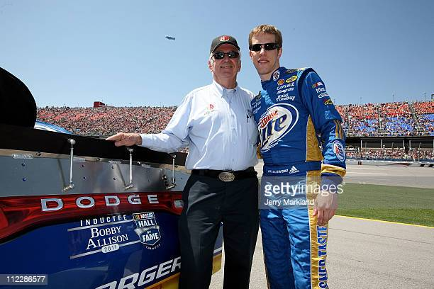 Hall of Famer Bobby Allison stands with Brad Keselowski driver of the Miller Lite Dodge before the NASCAR Sprint Cup Series Aaron's 499 at Talladega...